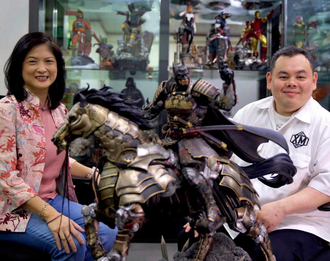 XM Studios CEO Ben Ang and ADDX CCO Oi Yee Choo, with XM's premium collectible statue Batman Shogun, from the Batman Samurai Line.
