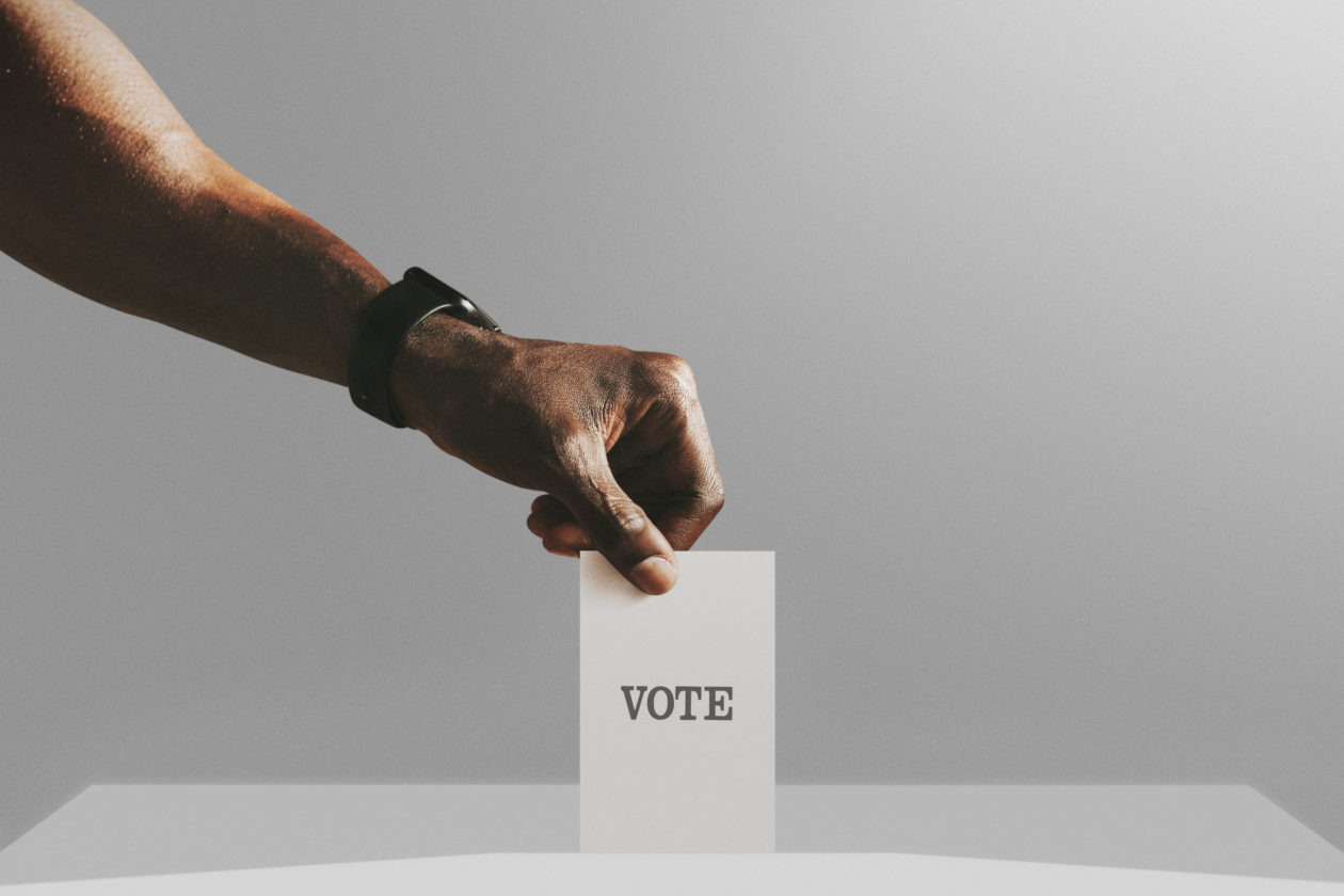 Man casting his vote to a ballot box mockup, quadratic funding can democratize community capital allocation