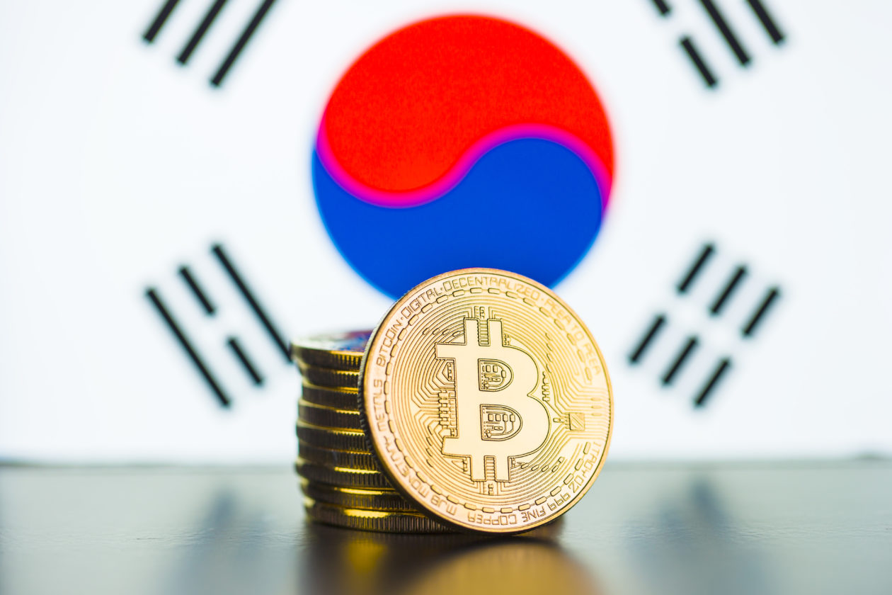 Golden bitcoins and South Korea flag.   South Korea updates crypto 'death note', says seven more will survive.