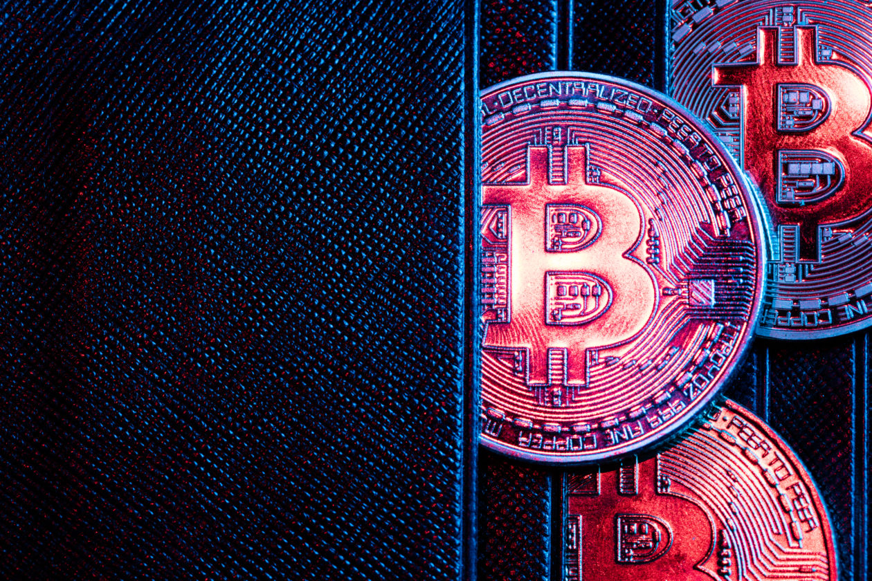 Bitcoin coins sticking out of a wallet   South Korean regulator says DeFi needs legal review